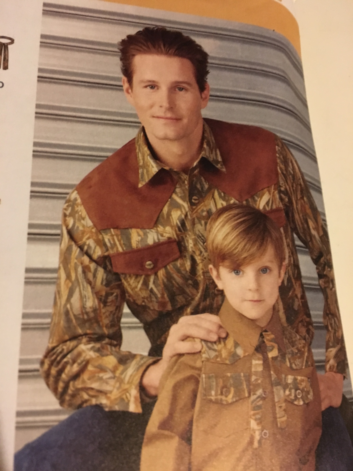 Picture of a pattern image with a man and boy wearing camouflage and brown shirts.